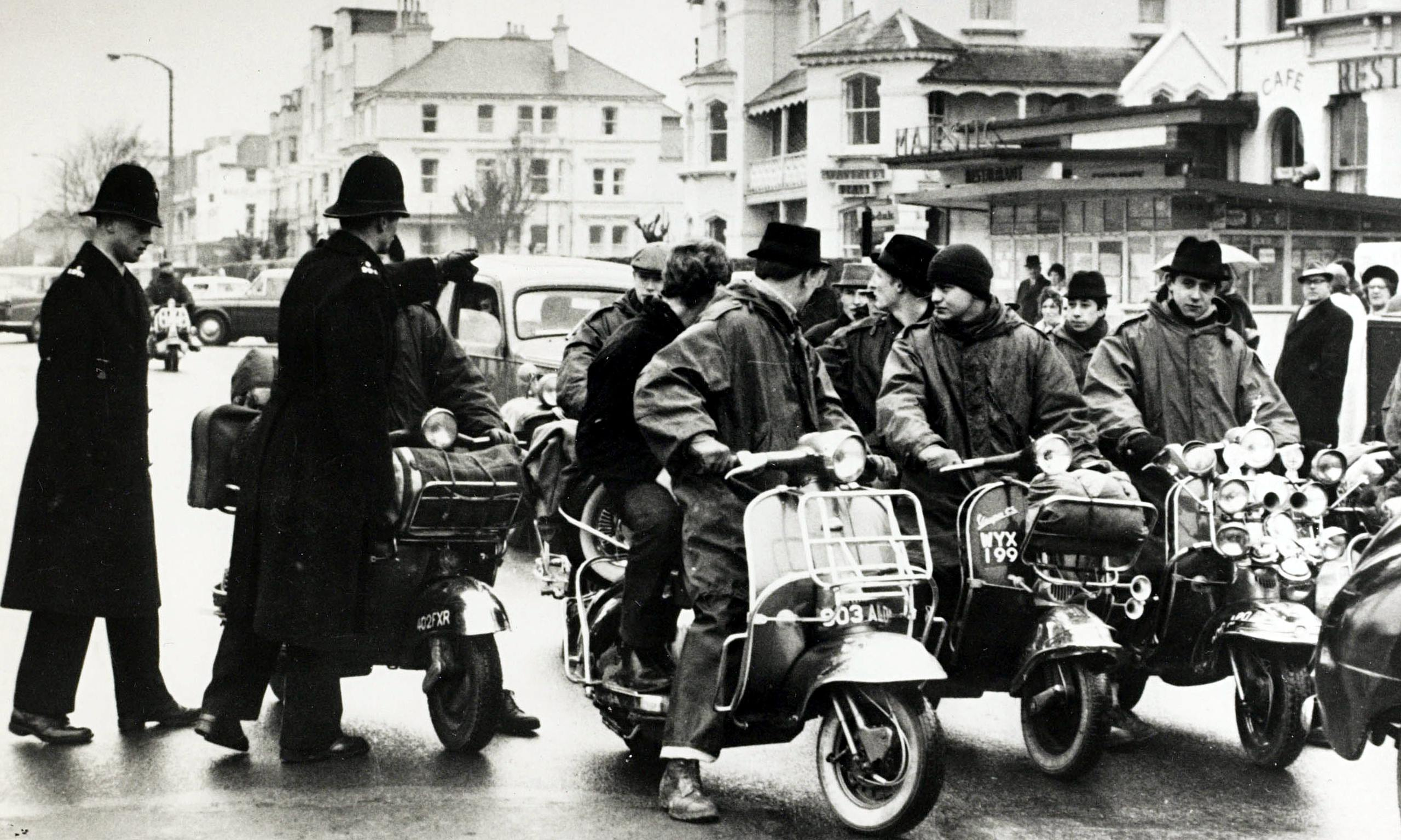 Police warn a group of mods arriving in Clacton, Essex, in 1964. Photograph: Popperfoto